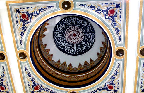 The domes, in and out, are decorated with verses from the Qur'an