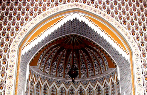 The mihrab is adorned with marble and mosaics