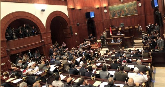 Members of Egypt's constitution committee meet at the Shura Council for the final vote on a draft new Egyptian constitution in Cairo