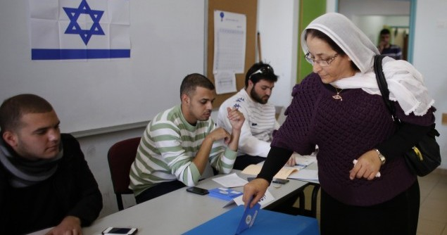 A Druze woman casts her ballot at a polling station in the northern Druze-Arab village of Maghar