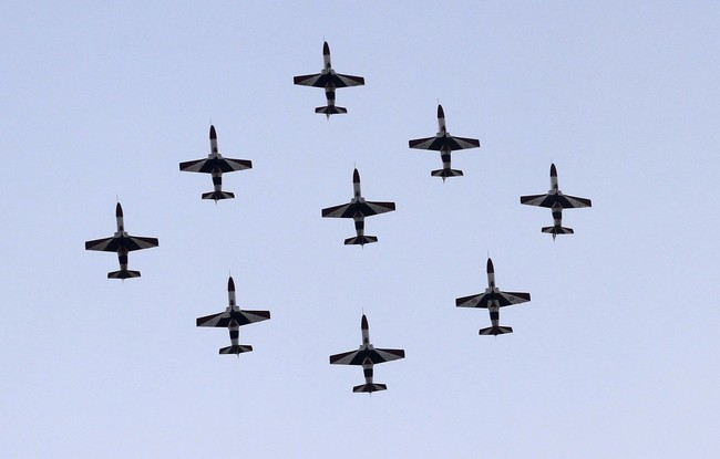 Egyptian military jets fly in formation over Tahrir square in Cairo
