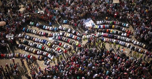Protesters, opposing Egyptian President Mohamed Mursi, pray during a protest demanding that Mursi resign at Tahrir Square in Cairo