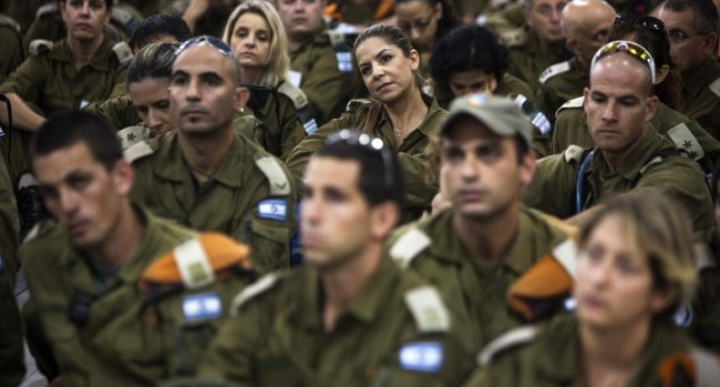 Israeli soldiers, part of an aid delegation to the Philippines, listen to a briefing at Ben Gurion international airport near Tel Aviv